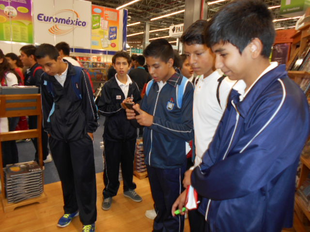 school boys captivated at the Arte Mexicano booth